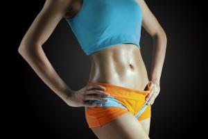 Sexy female's body part on dark background